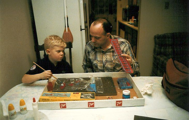 Hugh III and Hugh Jr. Working on a Piper Cub balsa wood model circa 1990