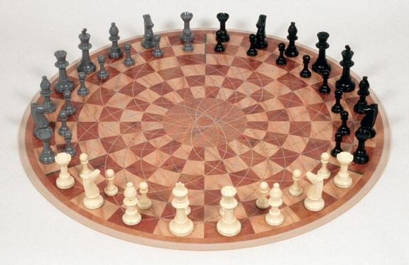 Three Man Chess on a Round Board