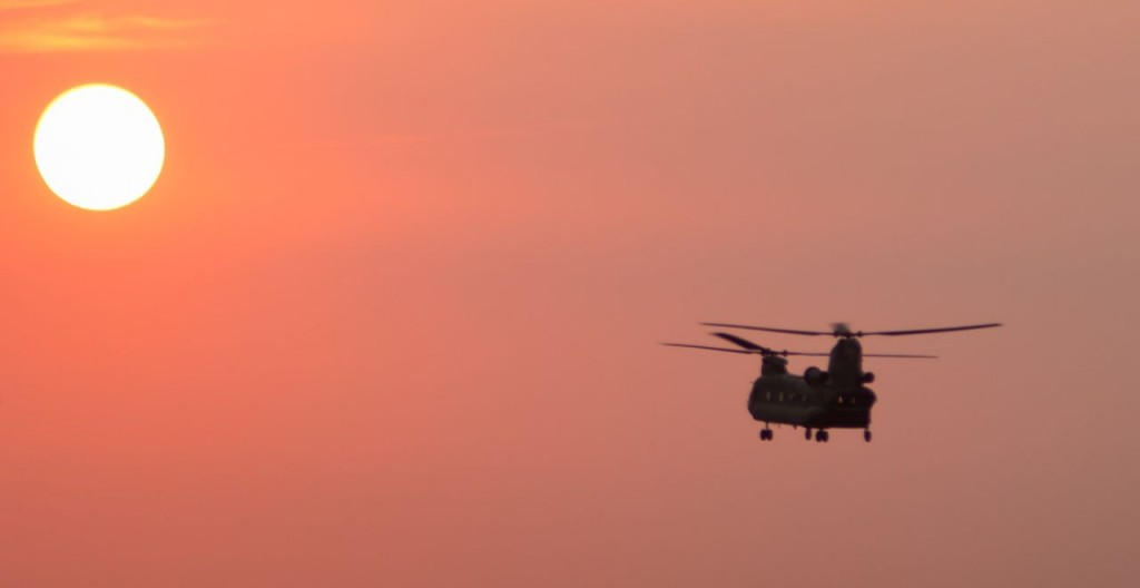 CH-47 Over Joe Pool Spillway at Sunset.