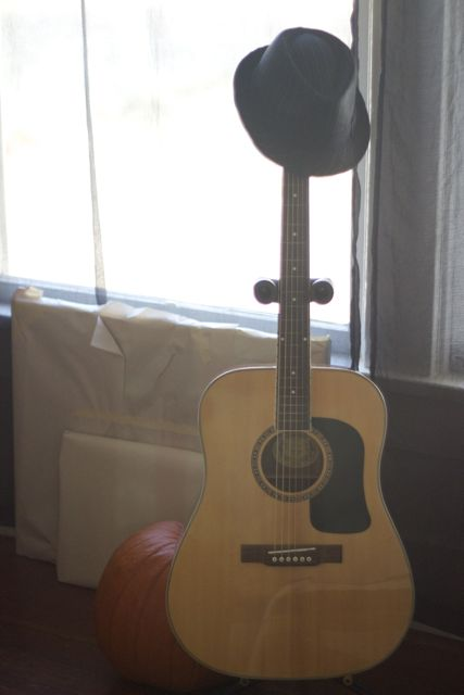Guitar stand and Hat.